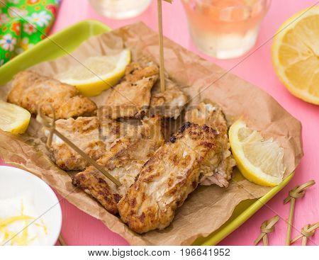Fried fish Pescado frito with lemon mayonnaise and white wine