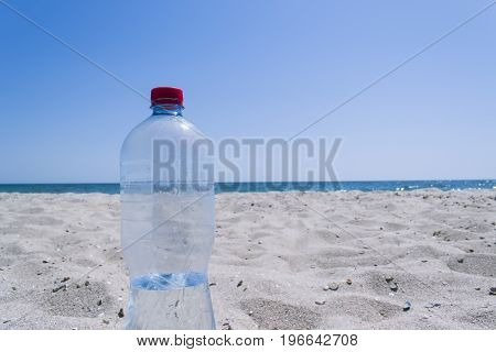 Empty Bottle On The Background Of The Sea