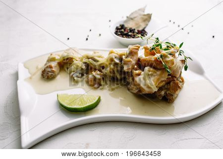Meat Rapan. Sea Food, Meat Rapana. Snack Meat Rapana On The Plate On A Wooden Board