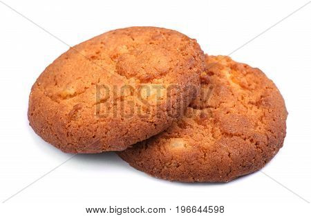 A close-up picture of a couple of crunchy cookies isolated over the white background. Yummy light brown biscuits for a healthful snack. A delicious homemade traditional pastry.