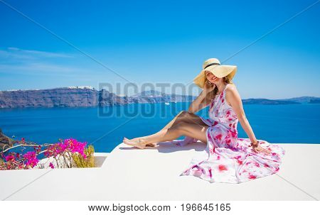 Summer fashion lady in hat and long dress