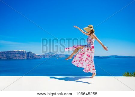 Carefree happy woman enjoying life in summer