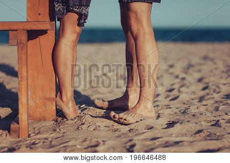 The Feet Of Lovers On The Beach