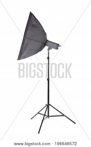 A modern gray softbox isolated over the white background. Professional lighting equipment for photo studios. A big stripbox with a flashlight on a tall tripod. Photographic accessory.