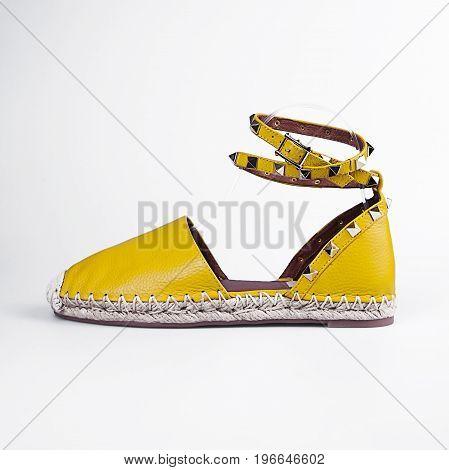 female yellow summer shoes over white background