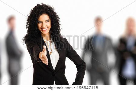 Portrait of a beautiful businesswoman offering an handshake