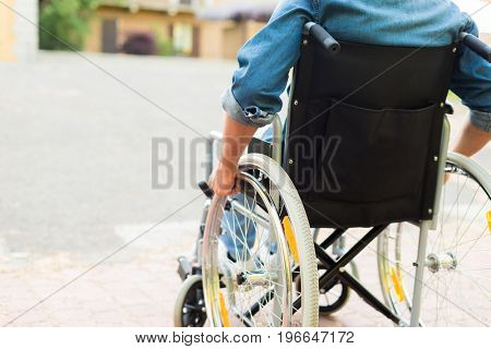 Detail of a disabled man trying to getting on a ramp