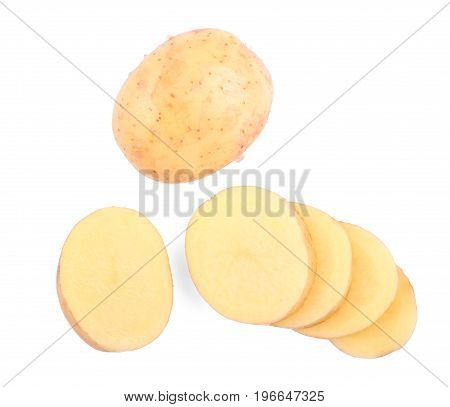 A view from above on uncooked bright cut potatoes isolated on a white background. A whole potato and perfectly chopped pieces full of nutritious starch. Autumn ingredients for homemade meals.