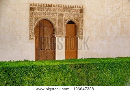 Detailed closeup view of decorated doors frame, Alhambra, Andalusia, Spain