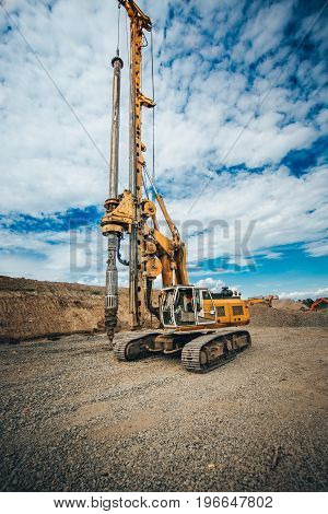 Details Of Heavy Duty Machinery On Construction Site. Detail Of Highway Building With Rotary Drillin