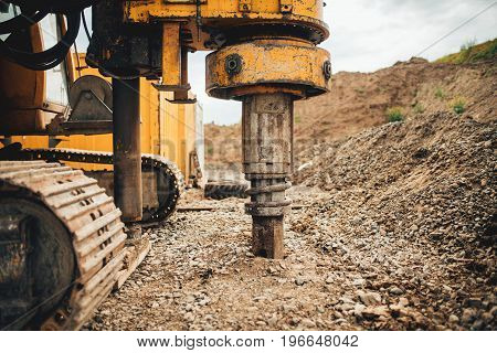 Rotary Drills, Bulldozer And Excavator Working On Highway Construction Site With Heavy Duty Machiner