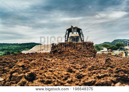Mini Bulldozer Moving Dirt And Earth With Scoop. Industrial Details Of Landscaping