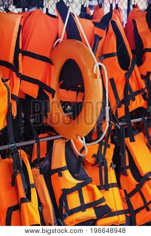 the orange life jacket and life ring