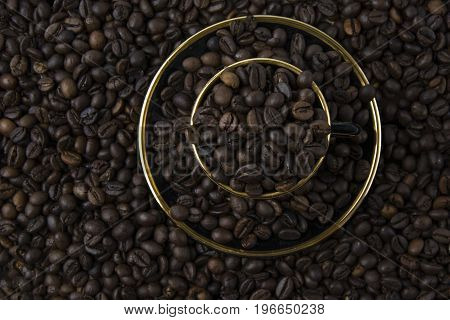 The roasted coffee beans are scattered on the table