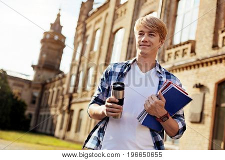 Another start. Handsome determined nice man attending university and heading to the lecture while bringing his notes with him