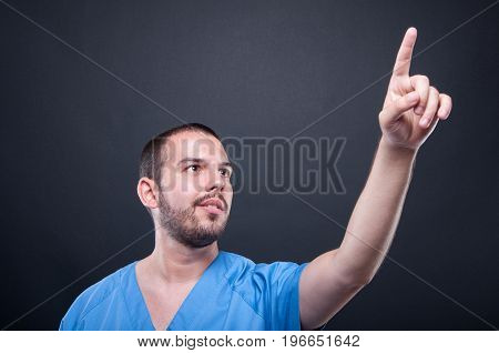 Man Medical Nurse Wearing Scrubs Using Invisible Touchscreen