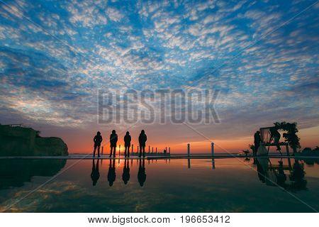 People On The Beach Near The Sea Meet The Dawn