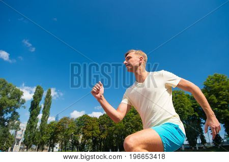 Man Running On Arena Track.