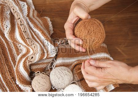 Knitting from natural wool closeup of the hands