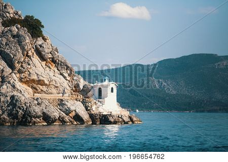 Lighthouse on the Greek island in the Aegean sea.