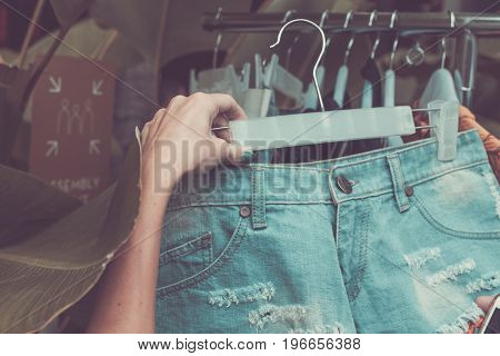 Woman new jeans shorts. New jeans shorts on showcase. Jeans shorts for ladies. Short shorts for women. Woman shopping on Bali.