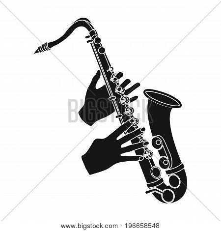The saxophonist plays the saxophone. Golden saxophone single icon in black style vector symbol stock illustration .