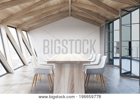 Attic conference room interior with a long wooden table rows of white chairs near it and glass doors. 3d rendering mock up