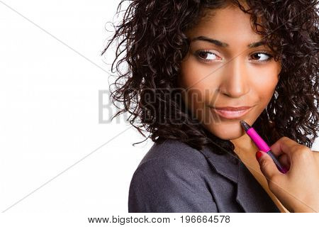 Thinking business woman holding pen