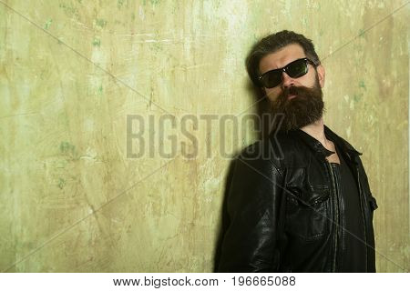 Hipster In Leather Jacket And Glasses.