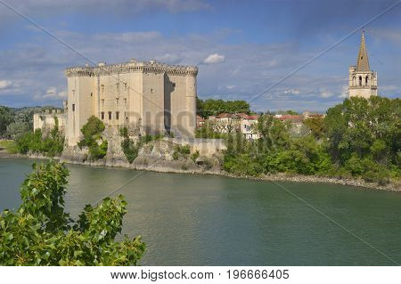 View to King Rene's castle and St Martha's Church from opposite bank of Rhone river. Tarascon France