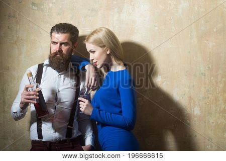 Couple In Love Posing With Bottle And Glass Of Liqueur