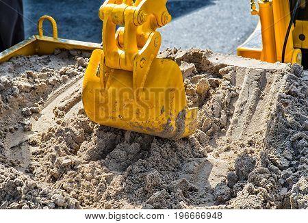 Close up Excavator Bucket. Sand and mud Expirience.