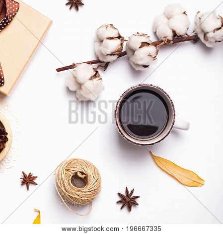 Autumn flat lay: coffee, cotton branch and other small objects