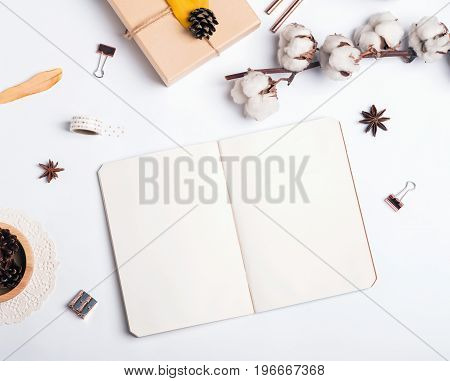 Blank notepad and autumn related items, top view