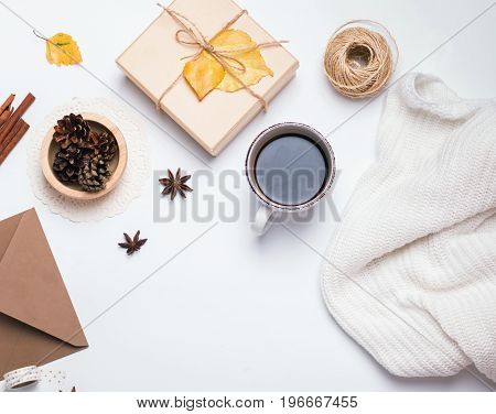 Coffee, sweater, pine cones and other small autumn related items