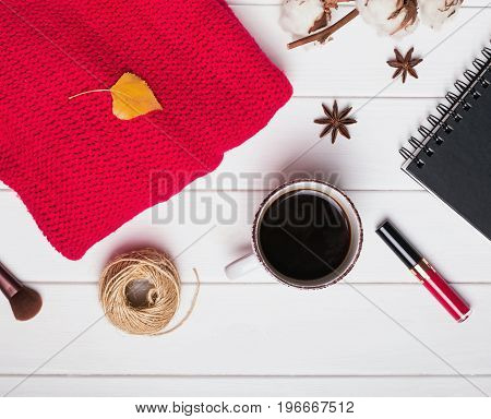 Red sweater, coffee and other small items. Autumn concept