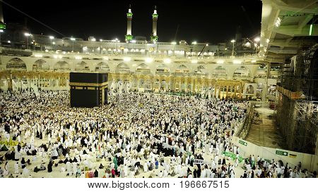MECCA, SAUDI ARABIA, April 17 2017 - Muslim pilgrims from all over the world gathered to perform Umrah at the Haram Mosque in Mecca. A crowd of pilgrims (tawaf) Kaaba with noise & Slow Motion.