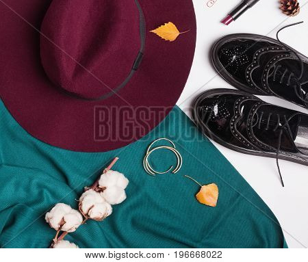 Autumn outfit. Hat, shoes and scarf top view