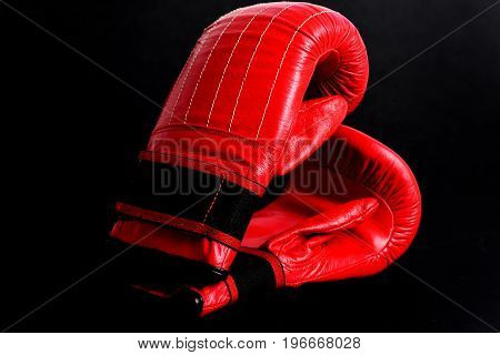 Black Studio Background With Red Mittens For Boxing