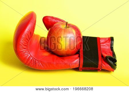 Boxing Gloves In Red. Sport Equipment And Fruit On Yellow