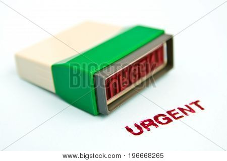 urgent letter on green rubber stamp isolated on white background