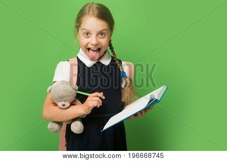 Study And Back To School Concept. Pupil Holds Book