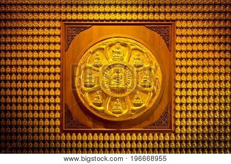Pattern of gold chinese buddha in temple