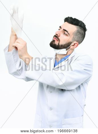 Surgeon With Beard Puts Glove On With Serious Face