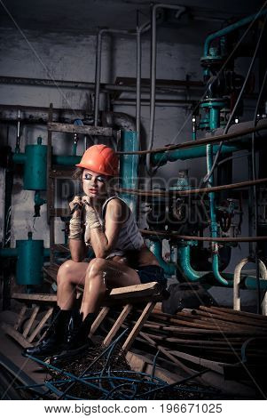 Beautiful Girl Wearing A Helmet In The Boiler Room
