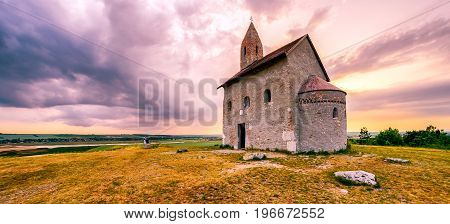 Lonely Drazovsky church in the country and dramatic colorful sky.