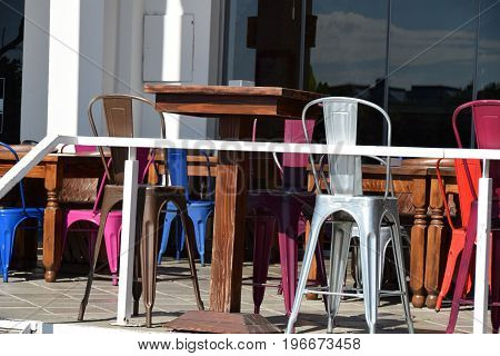 Multicolour plastic chairs on the terrace of the restaurant