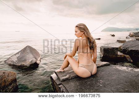 Slim woman in bikini swimsuit, tropical Hawaiian island, summer vacation
