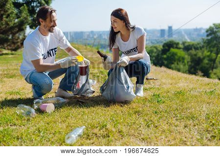 On guard of environment. Dedicated intelligent progressive citizens participating in eco campaign and cleaning local park from litter while taking part in it pro bono