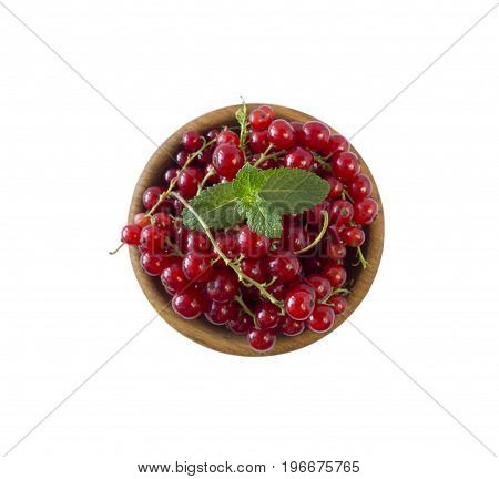 Currant and mint isolated on white background cutout. Red currant in a wooden bowl with copy space for text. Top view.